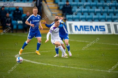 Shrewsbury Town midfielder Shaun Whalley (7) and Gillingham FC midfielder Stuart O'Keefe (4) during the EFL Sky Bet League 1 match between Gillingham and Shrewsbury Town at the MEMS Priestfield Stadium, Gillingham
