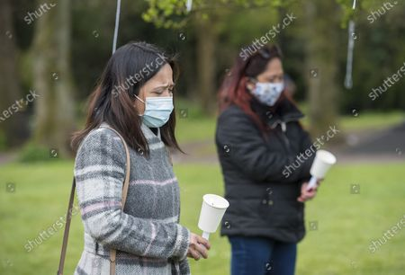 Stock Photo of ; Bristol, UK. A vigil takes place on Brandon Hill for Bennylyn Burke aged 25 and her two-year-old daughter Jellica during the Covid-19 coronavirus pandemic in England. Bennylyn and Jellica lived in Kingswood near Bristol and their bodies were discovered in Troon Avenue, Dundee, on Thursday, March 18. Bennylyn moved to the UK from the Philippines in 2019 for a better life, and a man Andrew Innes is accused of their murder.