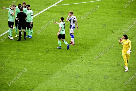 Moenchengladbach's goalkeeper Yann Sommer (R) leaves the pitch after booking red card during the German Bundesliga soccer match between Hertha BSC and Borussia Moenchengladbach in Berlin, Germany, 10 April 2021.