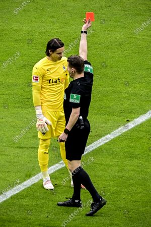 Moenchengladbach's goalkeeper Yann Sommer (L) is booked red card by referee Patrick Ittrich (R) during the German Bundesliga soccer match between Hertha BSC and Borussia Moenchengladbach in Berlin, Germany, 10 April 2021.
