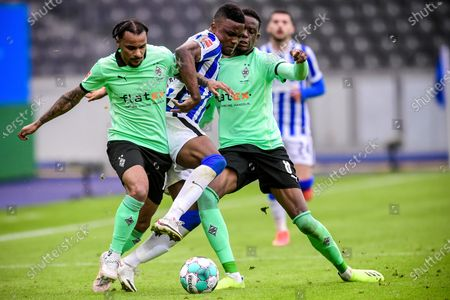 Stock Image of Moenchengladbach's Valentino Lazaro (L) and Denis Zakaria (R) in action against Hertha's Jhon Cordoba (C) during the German Bundesliga soccer match between Hertha BSC and Borussia Moenchengladbach in Berlin, Germany, 10 April 2021.