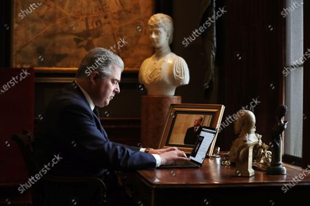 Stock Photo of Secretary of State for Northern Irelan Brandon Lewis signs a book of condolence after soldiers from 206 Battery, 105 Royal Artillery take part in a gun salute to the Duke of Edinburgh takes place at Hillsborough Castle in Northern Ireland.