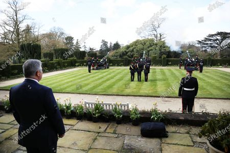 Secretary of State for Northern Irelan Brandon Lewis looks on as soldiers from 206 Battery, 105 Royal Artillery take part in a gun salute to the Duke of Edinburgh takes place at Hillsborough Castle in Northern Ireland.