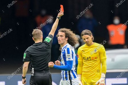 Moenchengladbach goalkeeper Yann Sommer, right, receives the red card by referee Patrick Ittrich during the German Bundesliga soccer match between Hertha BSC Berlin and Borussia Moenchengladbach in Berlin, Germany
