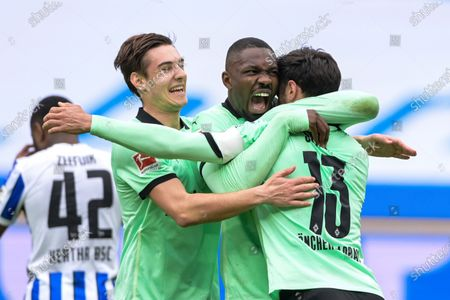 Front from left, Moechengladbach's Florian Neuhaus, Marcus Thuram and the scorer Lars Stindl celebrate their side's second goal during the German Bundesliga soccer match between Hertha BSC Berlin and Borussia Moenchengladbach in Berlin, Germany