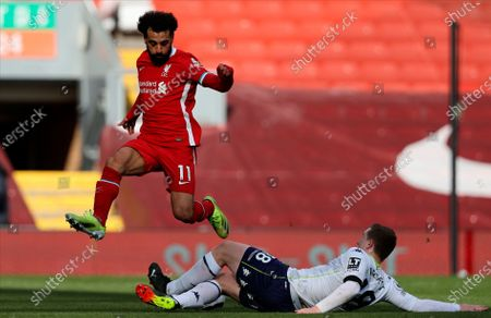 Liverpool's Mohamed Salah (up) is tackled by Aston Villa's Matt Targett (down) during the English Premier League soccer match between Liverpool and Aston Villa in Liverpool, Britain, 10 April 2021.