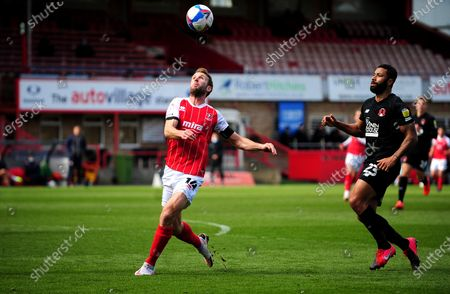 Andy Williams of Cheltenham Town under pressure from Jamie Turley of Leyton Orient- Mandatory by-line: Nizaam Jones/JMP