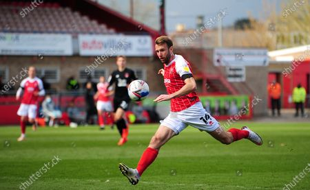 Andy Williams of Cheltenham Town attacks forward with the ball