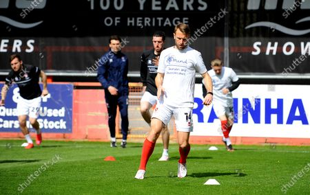 Andy Williams of Cheltenham Town warms up prior to kick-off