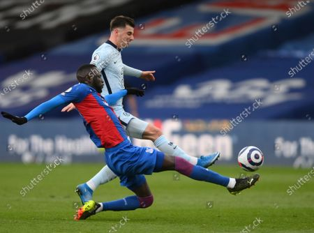 Crystal Palace's Cheikhou Kouyate, front, duels for the ball with Chelsea's Mason Mount during the English Premier League soccer match between Crystal Palace and Chelsea at Selhurst Park stadium in London