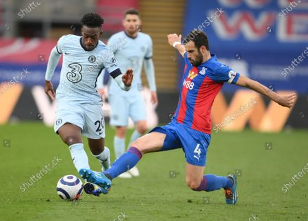 Chelsea's Callum Hudson-Odoi, left, duels for the ball with Crystal Palace's Luka Milivojevic during the English Premier League soccer match between Crystal Palace and Chelsea at Selhurst Park stadium in London