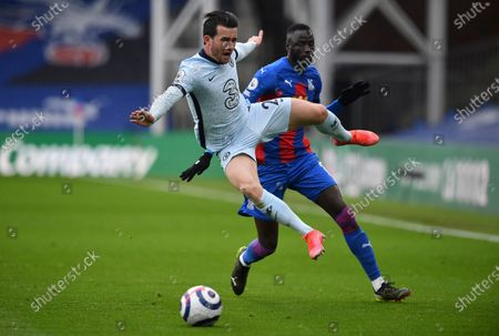 Chelsea's Ben Chilwell, front, duels for the ball with Crystal Palace's Cheikhou Kouyate during the English Premier League soccer match between Crystal Palace and Chelsea at Selhurst Park stadium in London