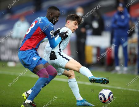 Chelsea's Kai Havertz, right, duels for the ball with Crystal Palace's Cheikhou Kouyate during the English Premier League soccer match between Crystal Palace and Chelsea at Selhurst Park stadium in London