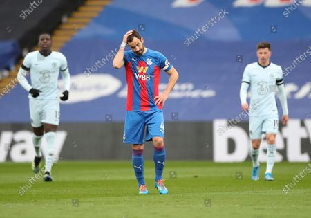 Crystal Palace's Luka Milivojevic, center, reacts after Chelsea's Christian Pulisic scoring his side's second goal during the English Premier League soccer match between Crystal Palace and Chelsea at Selhurst Park stadium in London
