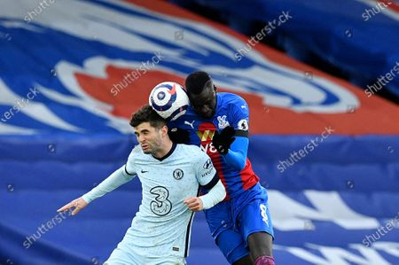 Chelsea's Christian Pulisic, left, duels for the ball with Crystal Palace's Cheikhou Kouyate during the English Premier League soccer match between Crystal Palace and Chelsea at Selhurst Park stadium in London