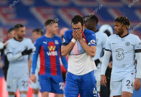 Crystal Palace's Luka Milivojevic, front, reacts after the English Premier League soccer match between Crystal Palace and Chelsea at Selhurst Park stadium in London