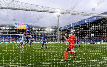 Crystal Palace's Christian Benteke scores his side's opening goal during the English Premier League soccer match between Crystal Palace and Chelsea at Selhurst Park stadium in London