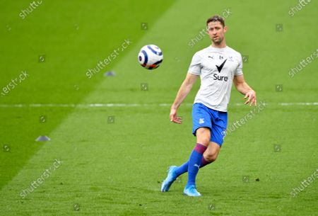 Crystal Palace's Gary Cahill kicks the ball during warm up before the English Premier League soccer match between Crystal Palace and Chelsea at Selhurst Park stadium in London