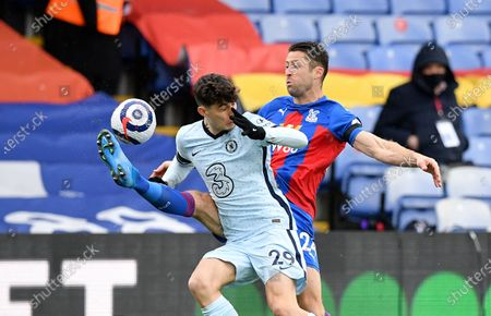 Stock Picture of Chelsea's Kai Havertz, front, duels for the ball with Crystal Palace's Gary Cahill during the English Premier League soccer match between Crystal Palace and Chelsea at Selhurst Park stadium in London