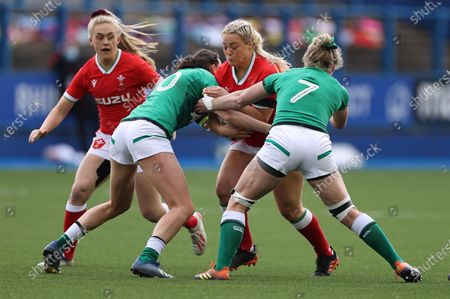 Kelsey Jones of Wales is tackled by Hannah Tyrrell and Claire Molloy of Ireland.