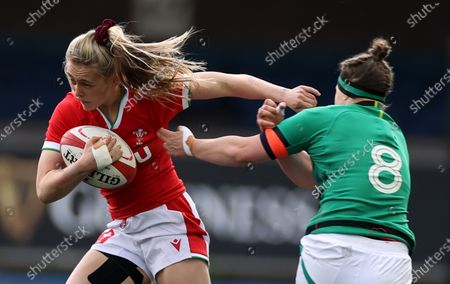 Hannah Jones of Wales is tackled by Ciara Griffin of Ireland.