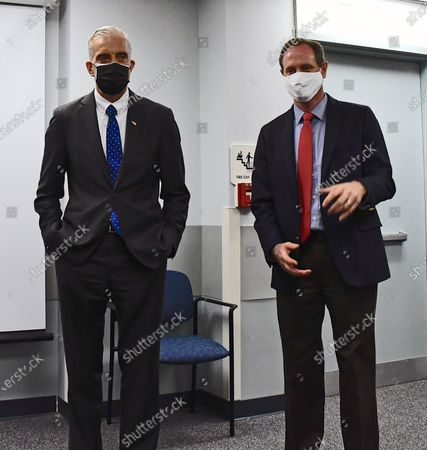 Stock Image of Veterans Affairs Secretary Denis McDonough (L) stands next to Congressman Tracy Mann (R-KS) with their masks prior to a news conference after touring newly installed facilities at Newman Regional Hospital to provide better treatment for local veterans