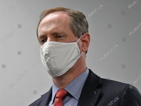 Stock Photo of Congressman Tracy Mann (R-KS) with his mask on listens to reporters questions during a news conference after touring newly installed facilities at Newman Regional Hospital to provide better treatment for local veterans