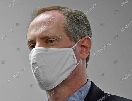 Congressman Tracy Mann (R-KS) with his mask on listens to reporters questions during a news conference after touring newly installed facilities at Newman Regional Hospital to provide better treatment for local veterans