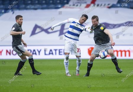Massimo Luongo of Sheffield Wednesday and Chris Willock of Queens Park Rangers scrap for the ball