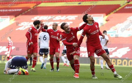 Stock Image of Liverpool's Trent Alexander-Arnold, right, celebrates after scoring his side's second goal during the English Premier League soccer match between Liverpool and Aston Villa at Anfield stadium in Liverpool, England