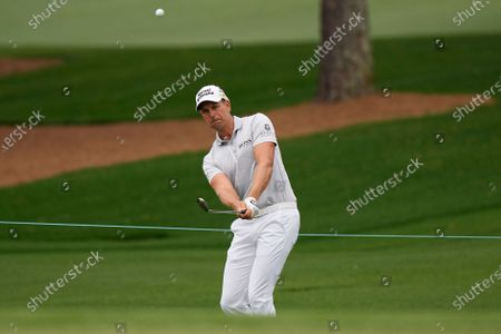 Henrik Stenson, of Sweden, hits to the third hole during the third round of the Masters golf tournament, in Augusta, Ga