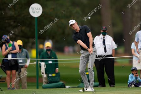 Martin Laird, of Scotland, hits to the second green during the third round of the Masters golf tournament, in Augusta, Ga