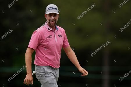 Stock Picture of Webb Simpson reacts after a birdie on the eighth hole during the third round of the Masters golf tournament, in Augusta, Ga