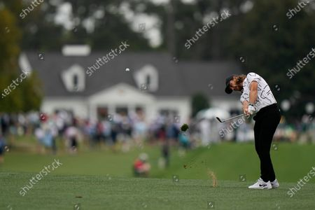 Tommy Fleetwood, of England, hits on the first fairway during the third round of the Masters golf tournament, in Augusta, Ga