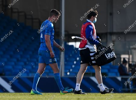 Johnny Sexton of Leinster Rugby leaves the field after picking up an injury