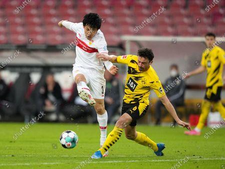 Wataru Endo of VfB Stuttgart battles for possession with Thomas Delaney of Borussia Dortmund during the Bundesliga match between VfB Stuttgart and Borussia Dortmund at Mercedes-Benz Arena in Stuttgart, Germany, 10 April 2021.