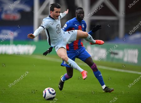Stock Photo of Cheikhou Kouyate of Crystal Palace (R) in action against Ben Chilwell of Chelsea (L) during the English Premier League match between Crystal Palace and Chelsea in London, Britain, 10 April 2021.