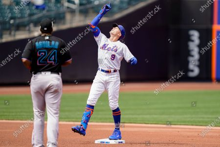 New York Mets' Brandon Nimmo (9) celebrates hitting a double off Miami Marlins starting pitcher Trevor Rogers in the first inning of a baseball game, in New York