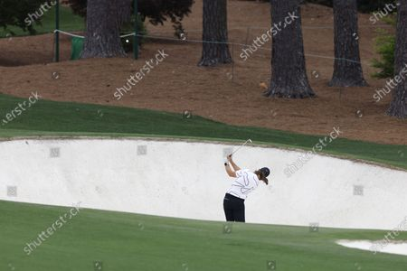 Stock Photo of Tommy Fleetwood of England hits out of a fairway bunker on the eighth hole during the third round of the 2021 Masters Tournament at the Augusta National Golf Club in Augusta, Georgia, USA, 10 April 2021. The 2021 Masters Tournament is held 08 April through 11 April 2021.