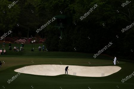 Matt Jones of Australia hits out of a bunker on the fourth hole during the third round of the 2021 Masters Tournament at the Augusta National Golf Club in Augusta, Georgia, USA, 10 April 2021. The 2021 Masters Tournament is held 08 April through 11 April 2021.