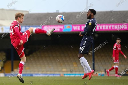 Josh Wright of Crawley Town makes a clearance