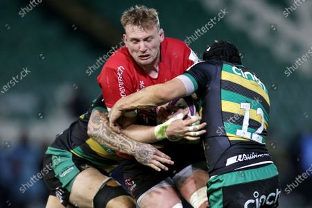 Stock Picture of Northampton Saints vs Ulster. Ulster's Kieran Treadwell is tackled by Teimana Harrison and Piers Francis of the Northampton Saints