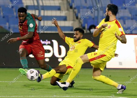 Stock Photo of Al-Ettifaq's player Ibrahim Mahnashi (L) in action against Al-Qadisiyah's Ibrahim Al-Sheail (C) and Rhys Williams (R) during the Saudi Professional League soccer match between Al-Ettifaq and Al-Qadisiyah at Prince Mohammed Bin Fahd Stadium, in Dammam, Saudi Arabia, 10 April 2021.