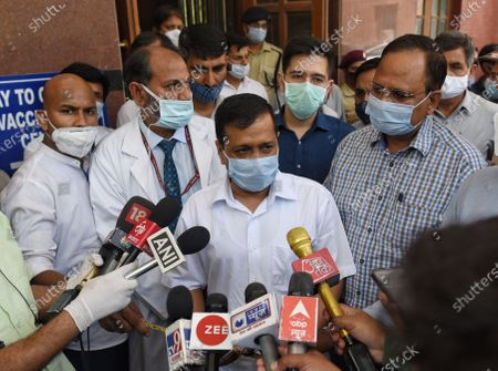 """Delhi Chief Minister Arvind Kejriwal interacts with the media after taking stock of arrangements, at LNJP Hospital, on April 10, 2021 in New Delhi, India. Amid escalating cases of COVID-19 in Delhi, Arvind Kejriwal said lockdown is """"not an option"""" but some restrictions will be put in place in the national capital which is reeling under the fourth wave of the coronavirus pandemic."""