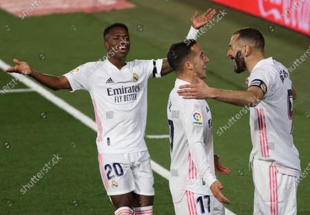 Real Madrid's Karim Benzema (R) celebrates with teammates Vinicius Jr (L) and Lucas Vazquez after scoring the 1-0 lead during the Spanish LaLiga soccer match between Real Madrid and FC Barcelona at Alfredo di Stefano stadium in Madrid, Spain, 10 April 2021.