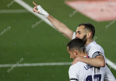 Real Madrid's Karim Benzema (R) celebrates with teammate Lucas Vazquez after scoring the 1-0 lead during the Spanish LaLiga soccer match between Real Madrid and FC Barcelona at Alfredo di Stefano stadium in Madrid, Spain, 10 April 2021.
