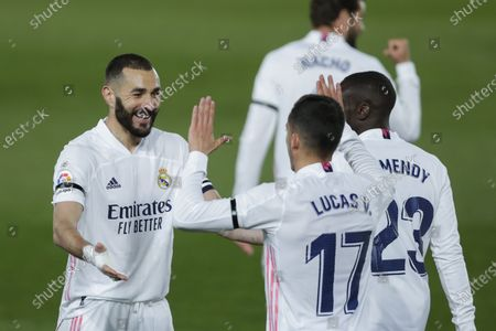 Real Madrid's Karim Benzema, left, celebrates with teammate Lucas Vazquez after scoring the opening goal during the Spanish La Liga soccer match between Real Madrid and FC Barcelona at the Alfredo di Stefano stadium in Madrid, Spain