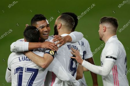 Real Madrid's Karim Benzema, center, celebrates with teammates Casemiro, second left, Lucas Vazquez, left, and Toni Kroos after scoring the opening goal during the Spanish La Liga soccer match between Real Madrid and FC Barcelona at the Alfredo di Stefano stadium in Madrid, Spain