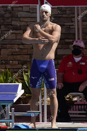 Andrew Wilson prepares to compete in the men's 200-meter breaststroke final at the TYR Pro Swim Series swim meet, in Mission Viejo, Calif