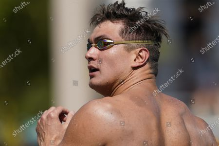 Nathan Adrian looks at the results after competing in the men's 50-meter freestyle final at the TYR Pro Swim Series swim meet, in Mission Viejo, Calif. Adrian finished fourth